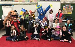Washington School class make funny faces for the camera as they show off their Halloween costumes.