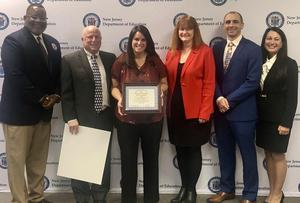 Photo of Dr. Lamont Repollet on the left - the Commissioner of Education; Kathy Goldenburg on the right -- the President of the State Board of Education; and Daryl Palmieri - the Union County Superintendent, posing with Drs. Perry and Dolan and teacher Christine Pitarresi during Blue Ribbon recognition in Trenton.