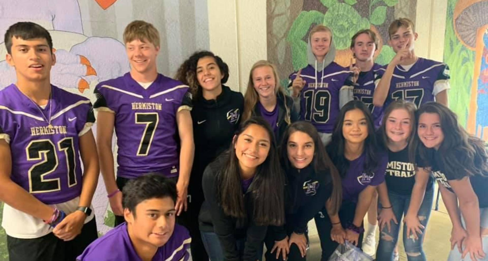 Sport athletes visiting Rocky Heights Elementary.