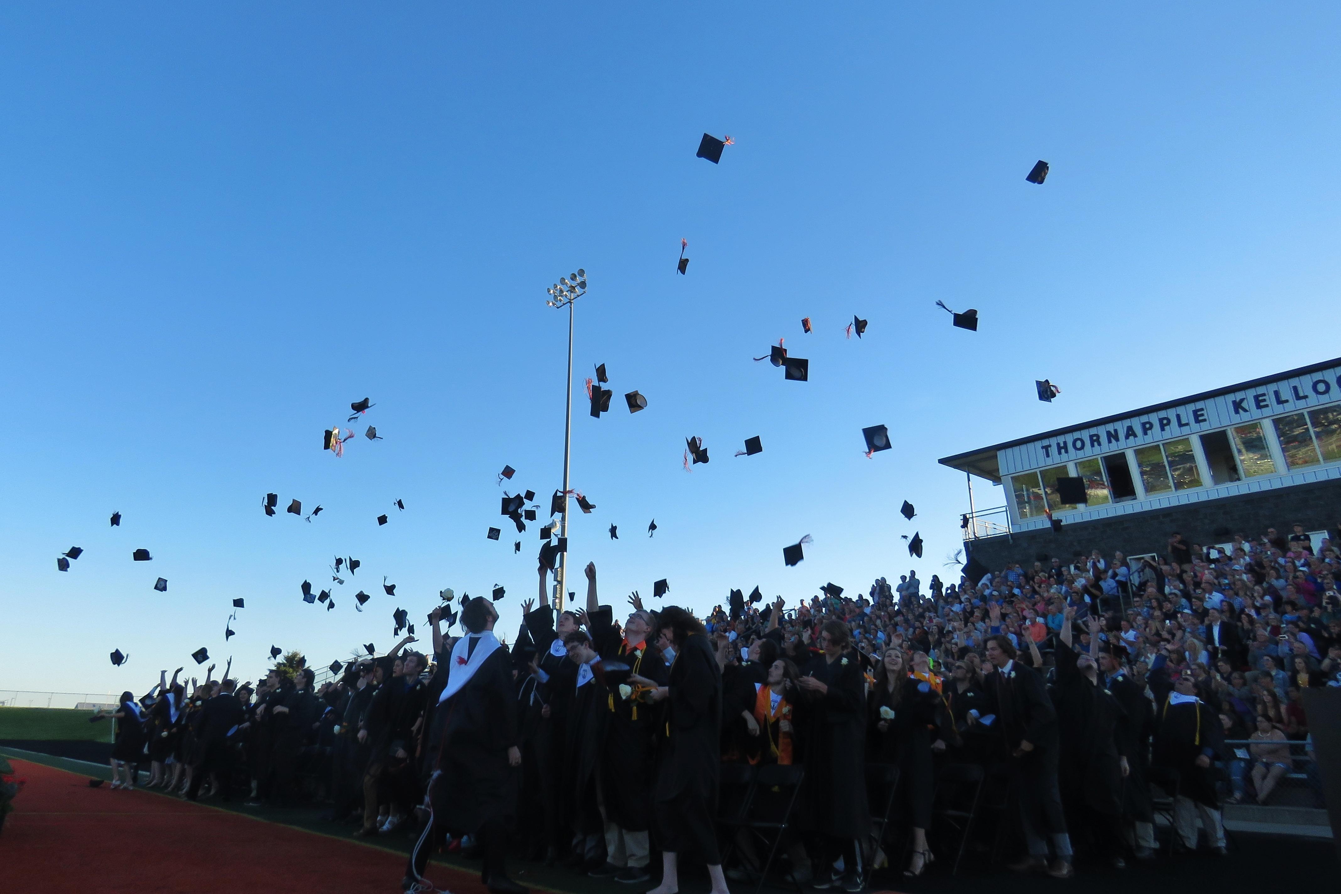 Thornapple Kellogg High School students celebrate at graduation.