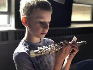 Student examines clarinet