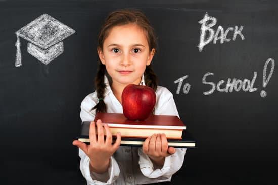 girl holding books, going back to school