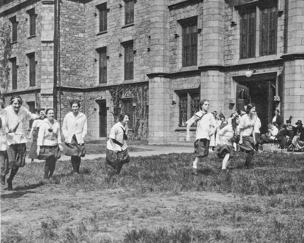 1911 Girls running on the school grounds