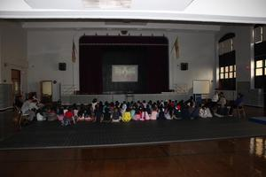 young children wearing their pjs watching the Polar Express in the gym
