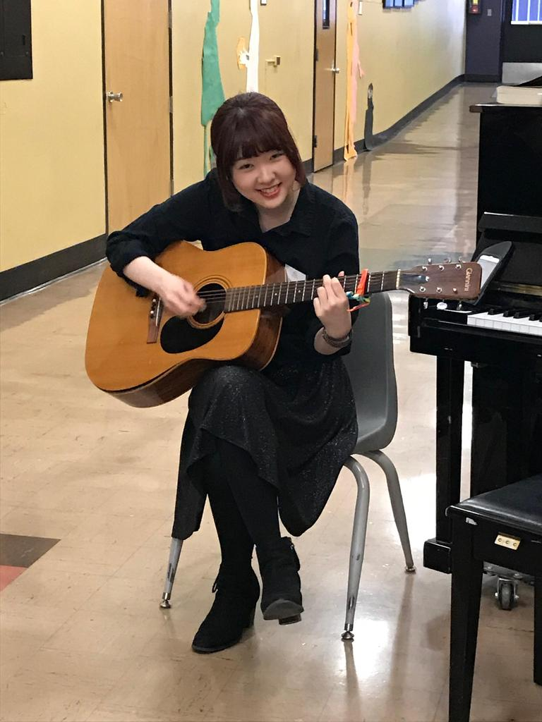 Student performing during Open House