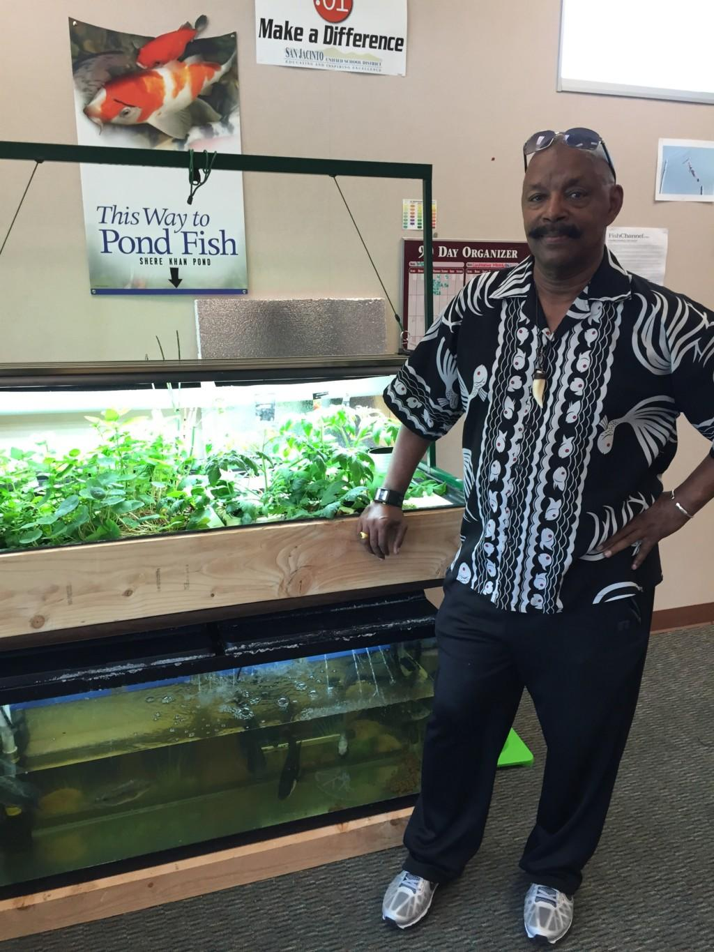 Dr. Smith seeing how the aquaponics system was going
