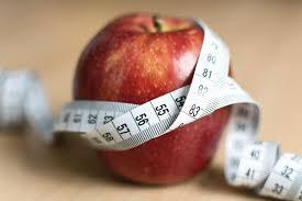 Picture of apple with tape measure around it