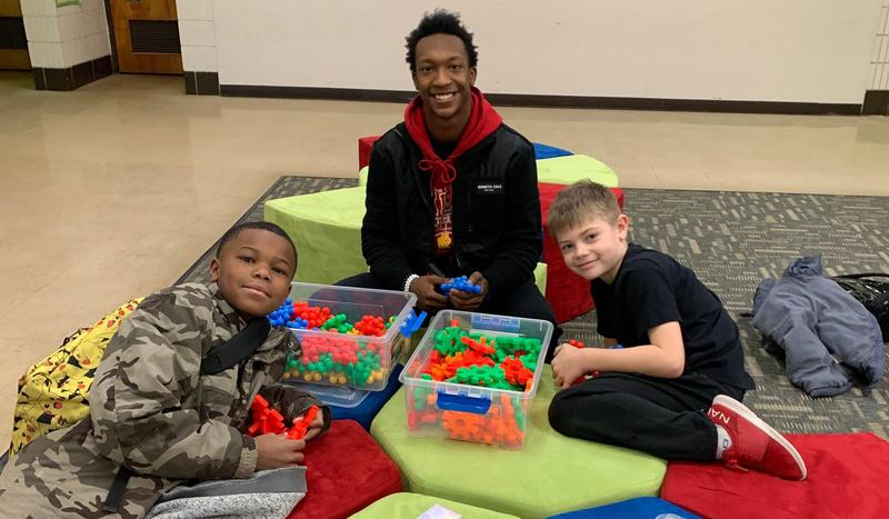 Rocky Football Players Mentoring Elementary Students Featured Photo