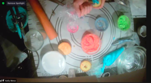 Vanilla cupcakes and different icing colors on zoom