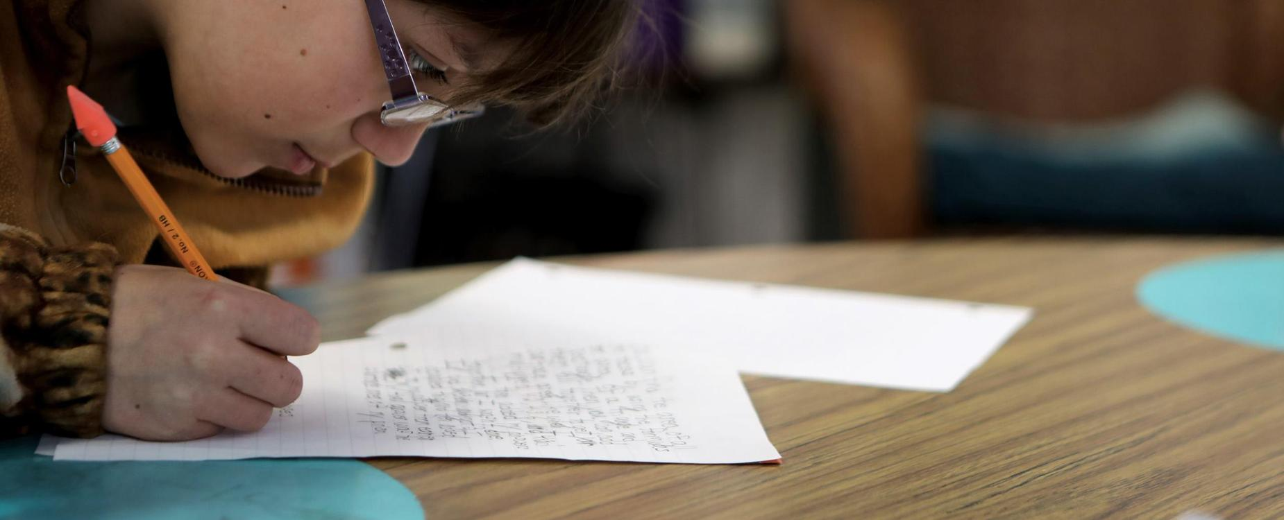 Student doing paperwork