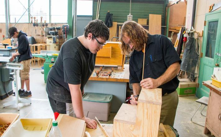Student and teacher in Woodshop