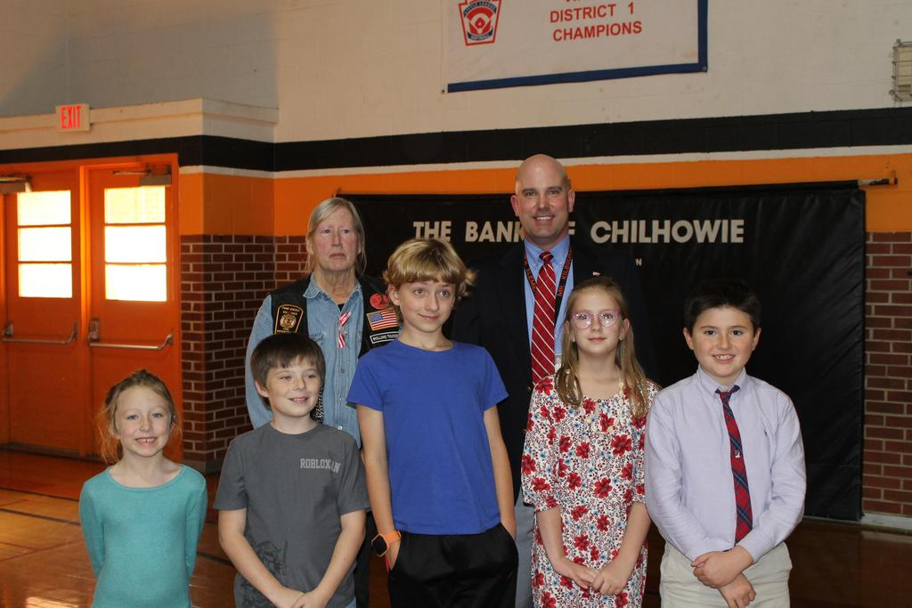 Students pictured with Mr. Kilbourne and representative from Wreaths Across America program