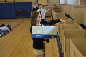 PJ Student packing boxes Food Drive