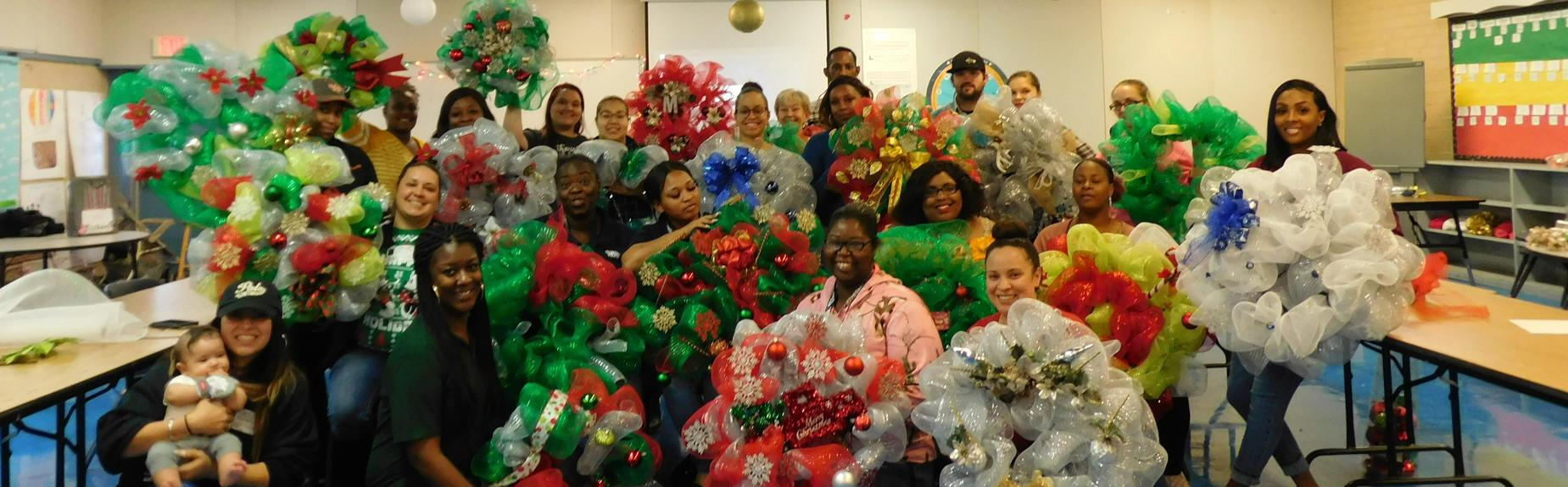 Parent learn how to make Christmas Wreaths at North workshop