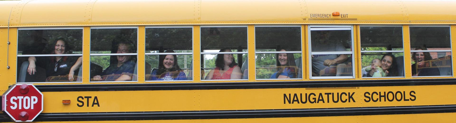 Bus drivers seen through window of bus
