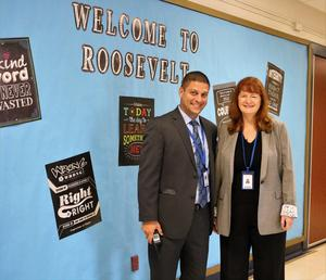 Roosevelt Intermediate School assistant principal Brian Gechtman and Superintendent Dr. Margaret Dolan pose in front of RIS sign during first week of school.
