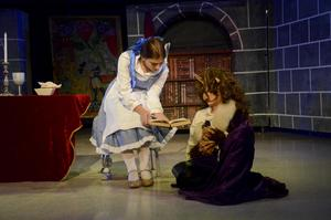 Middle school students performing in Beauty and The Beast Jr.