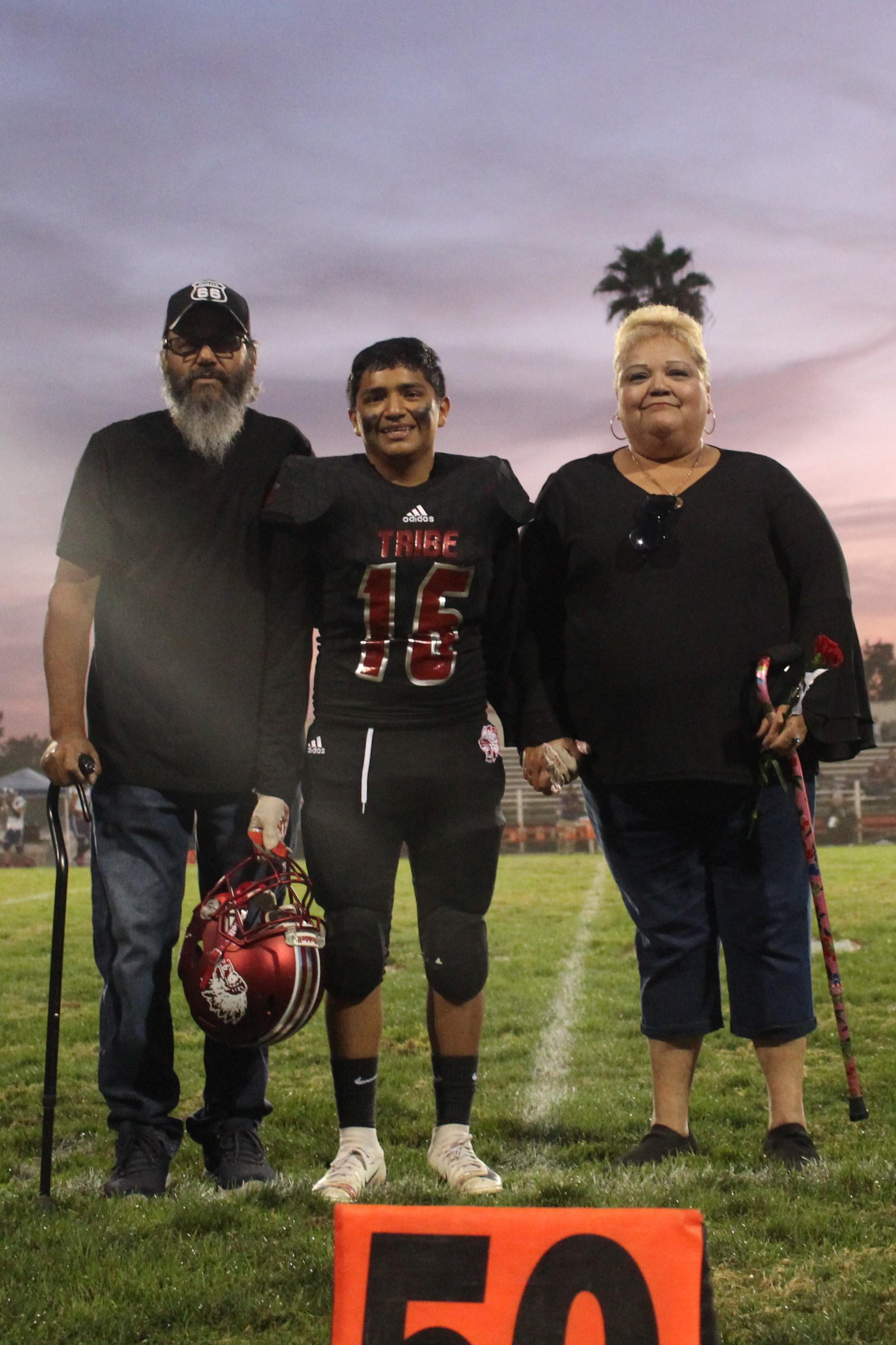 Senior football player Matthew Hernandez and his escorts.
