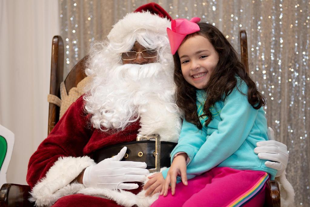 A girl visits with Santa