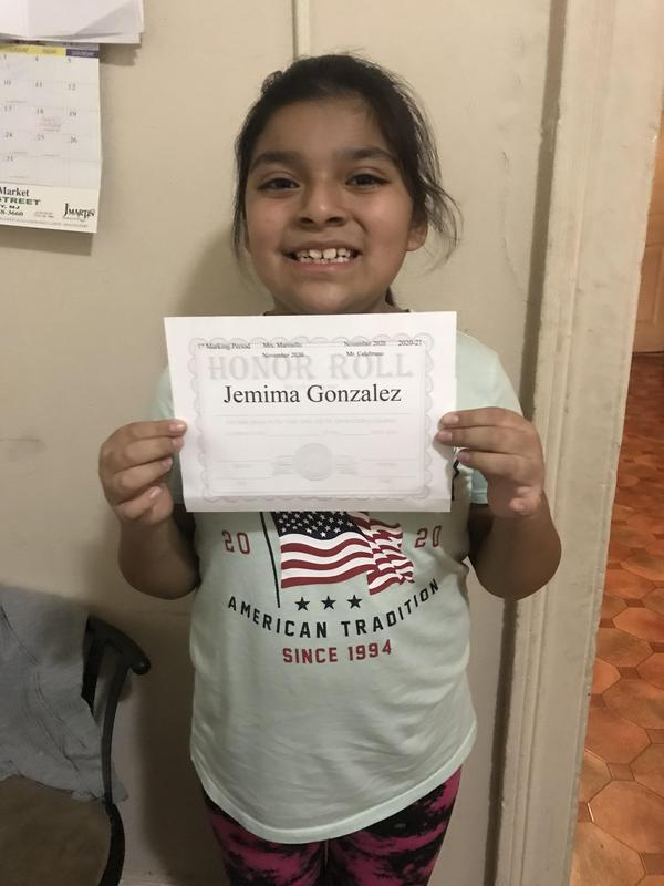 Jemima holding honor roll certificate