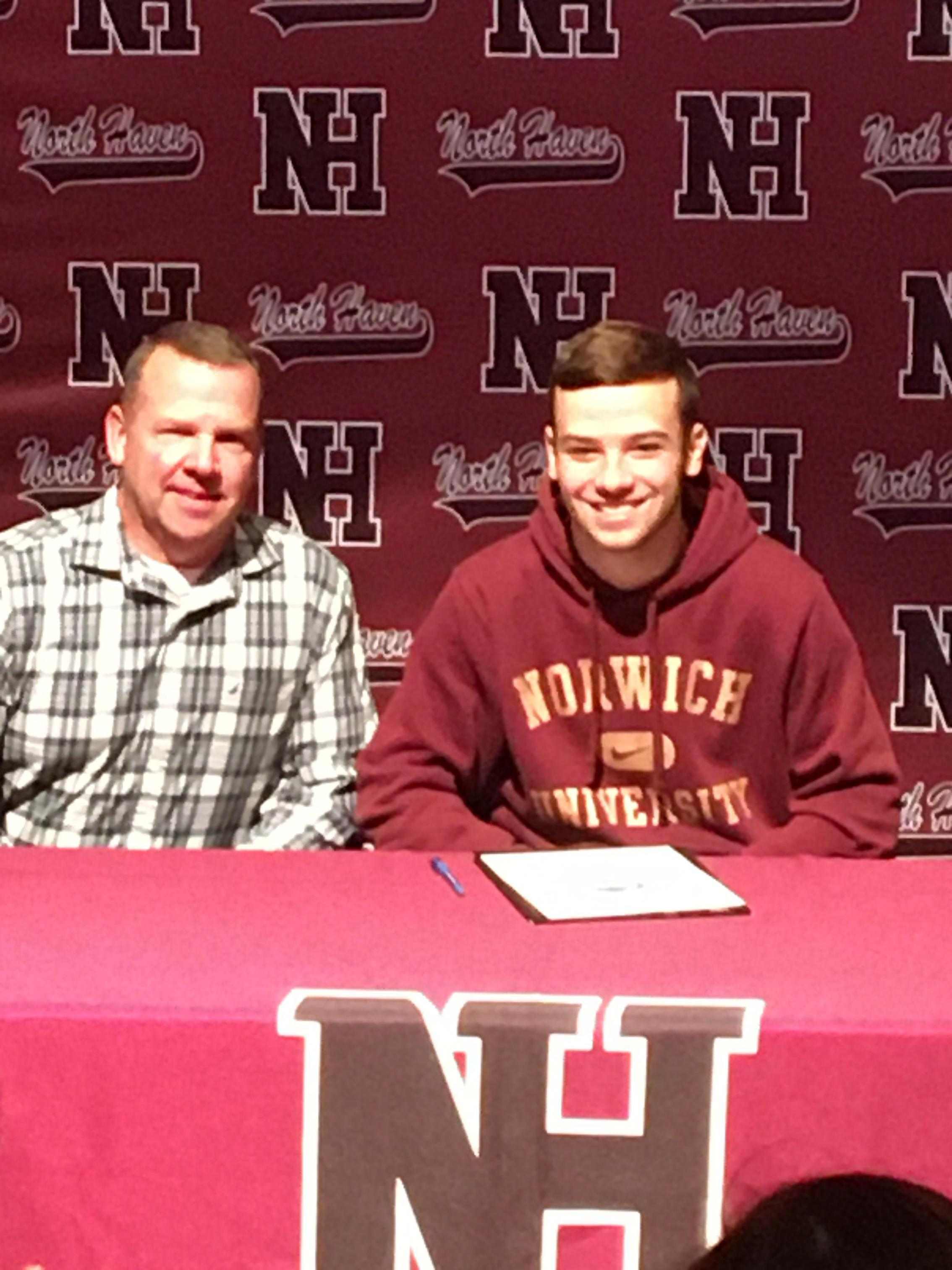 Owen Silk with his father after signing his NLI.