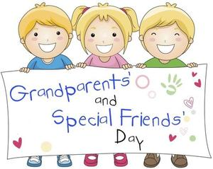 Children holding sign that says Grandparents and Special Friends