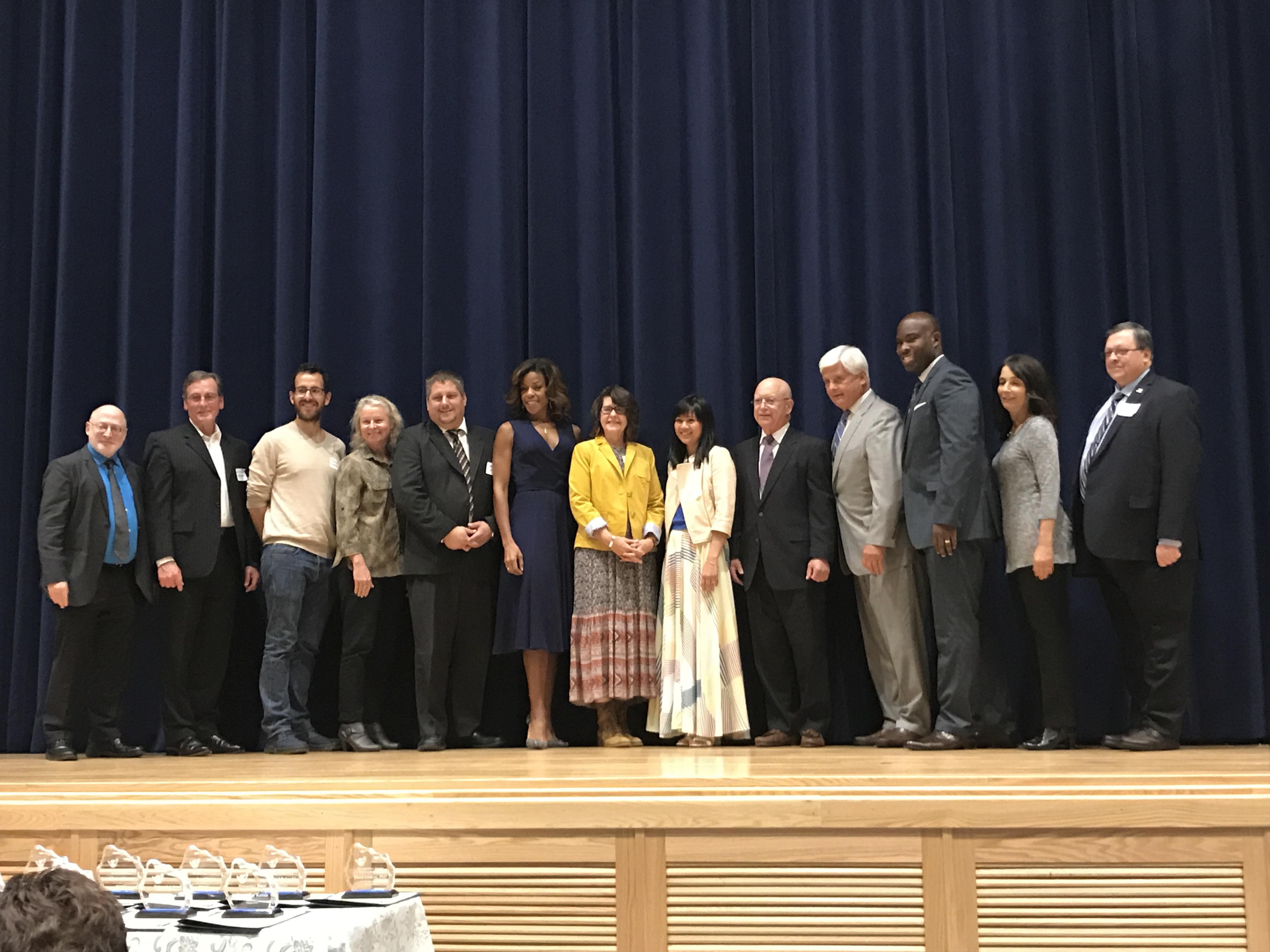14 Bensalem High School Distinguished Alumni pose for photo during October 2017 Induction Ceremony.