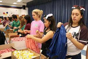 Volunteers at the backpack stuffing event for the Back-to-School Bash.
