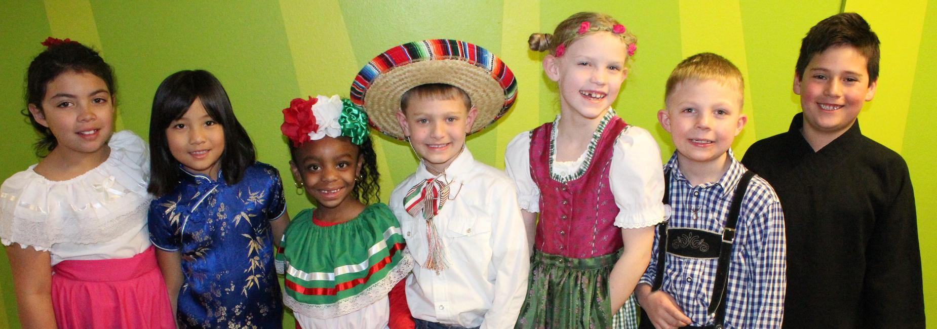 students dressed in different cultural outfits