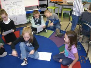 Second grade students share with first graders on Government Day.