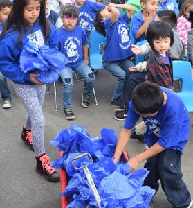 BPUSD_Heath_3: Students at Margaret Heath Elementary collect bags of pennies used to fund an annual scholarship in the longtime educator's name.