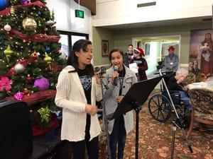RMCHS students performing at Sierra View Homes.