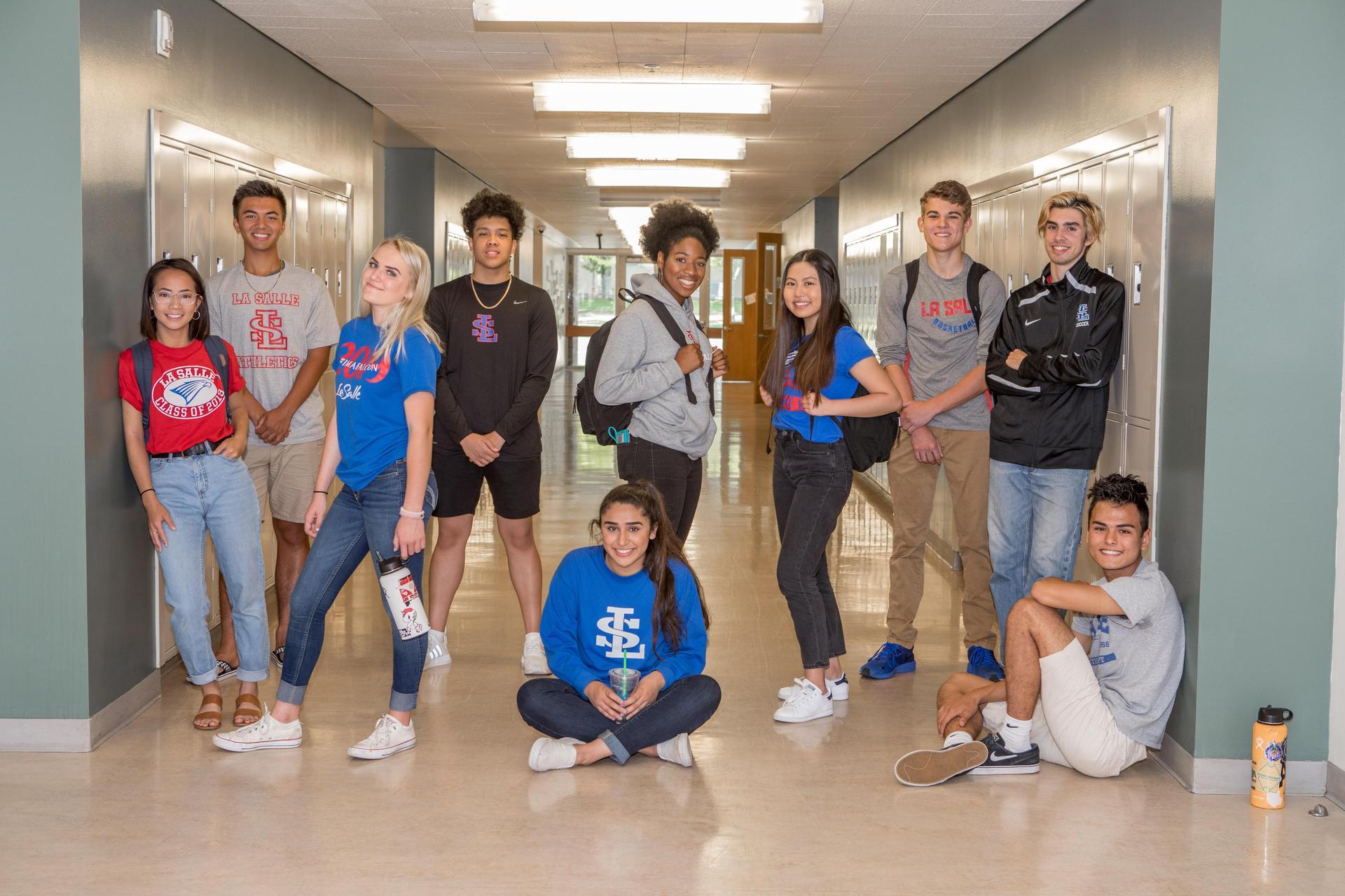 high school students standing in hallway of school