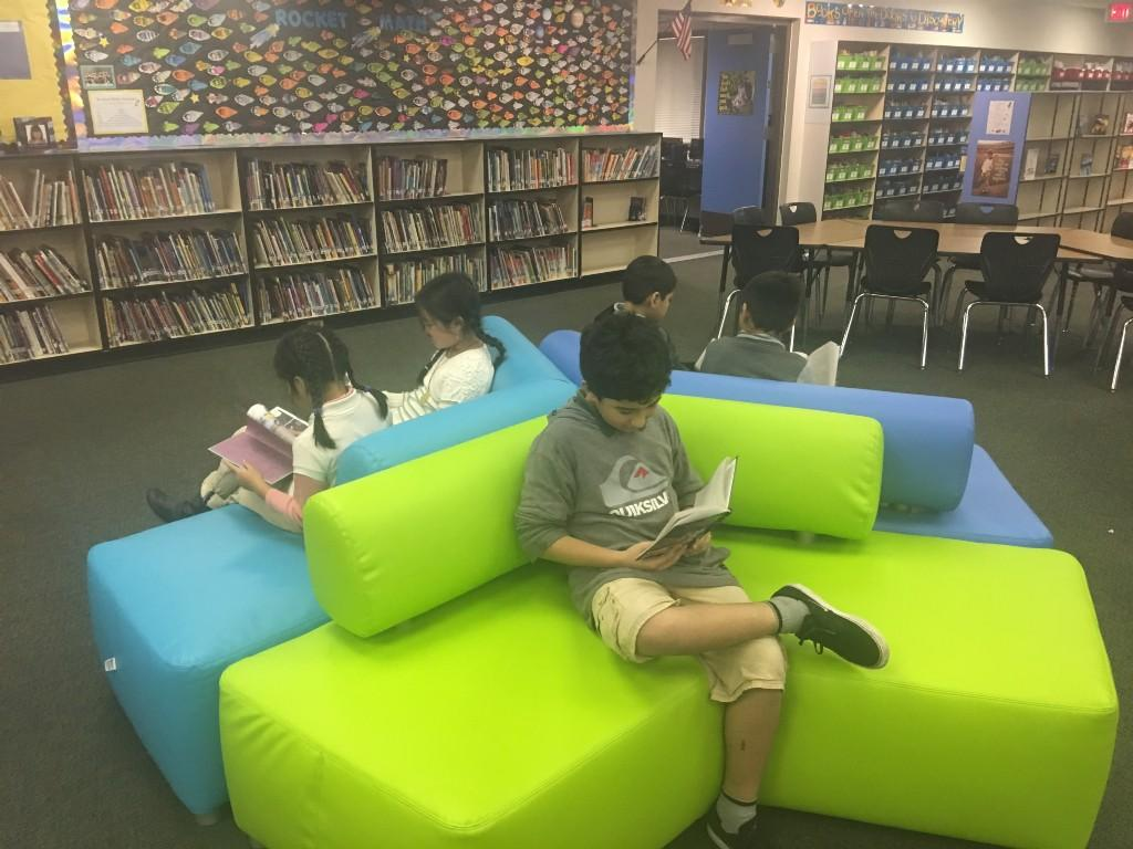 students reading in library