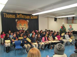 children seated at honors assembly