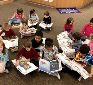 Students reading their new gift book, Blizzard.