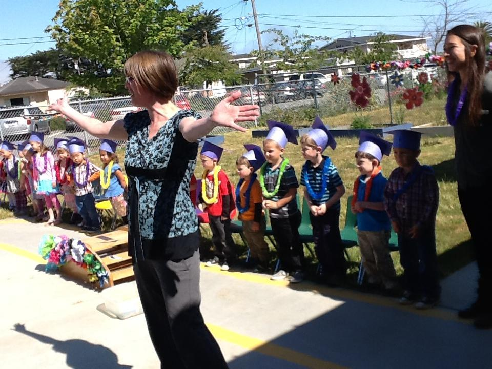 graduation welcome with preschoolers in back