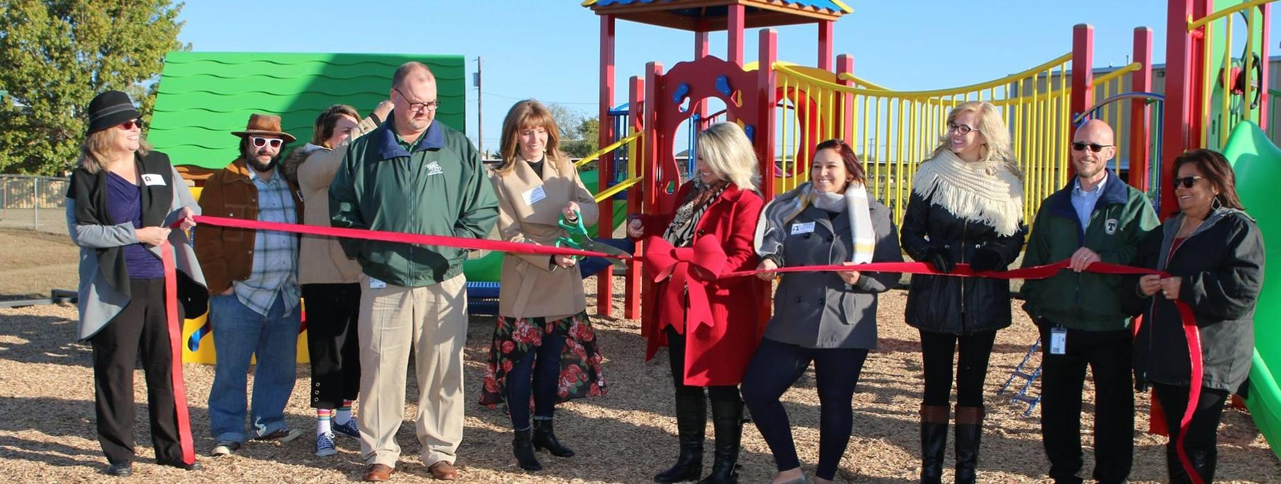 ribbon cutting for new playground