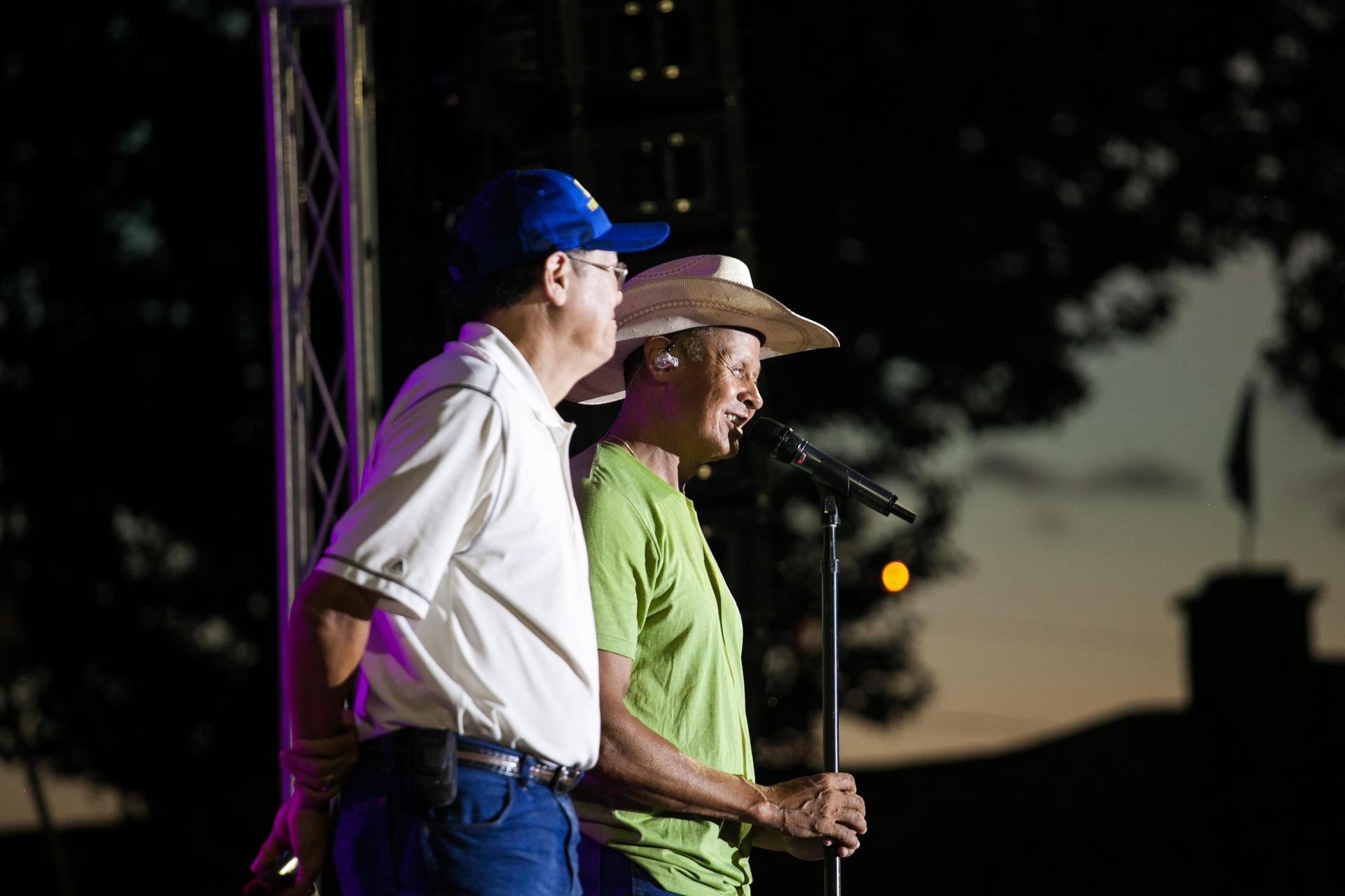 Neal and his brother, Gary singing