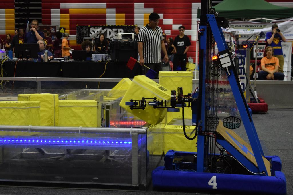 Main robot scoring Power Cube in Switch