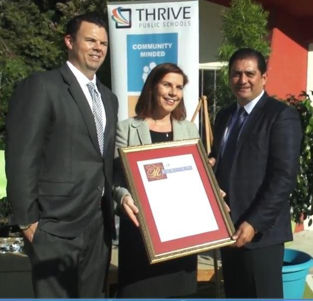 CEO Nicole Assisi receives a Resolution from the California State Senate on behalf of Thrive Public Schools