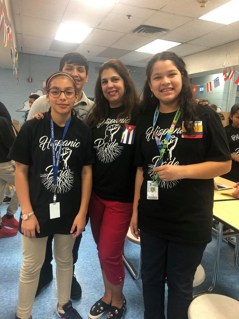 Mrs. Camacho with three of her students