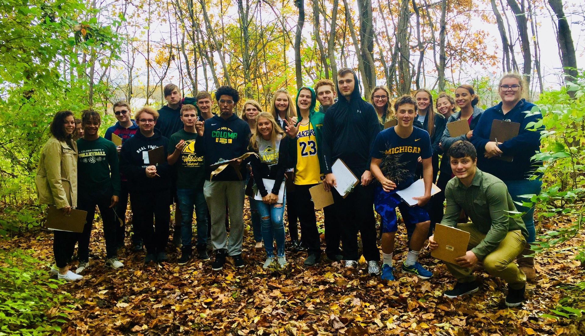 Advanced Biology students learn to identify trees, flowers, grasses, and shrubs on our school property