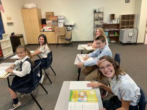 Legacy Preparatory Academy best charter school in Davis County kids smiling in classroom