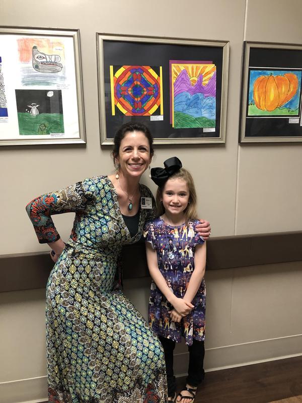 Ivah Litwin and Mrs. Mulkey at art display at Novant Health Center.