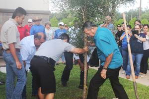 Jesus Trejo Jr.'s family helping with planting of the tree.
