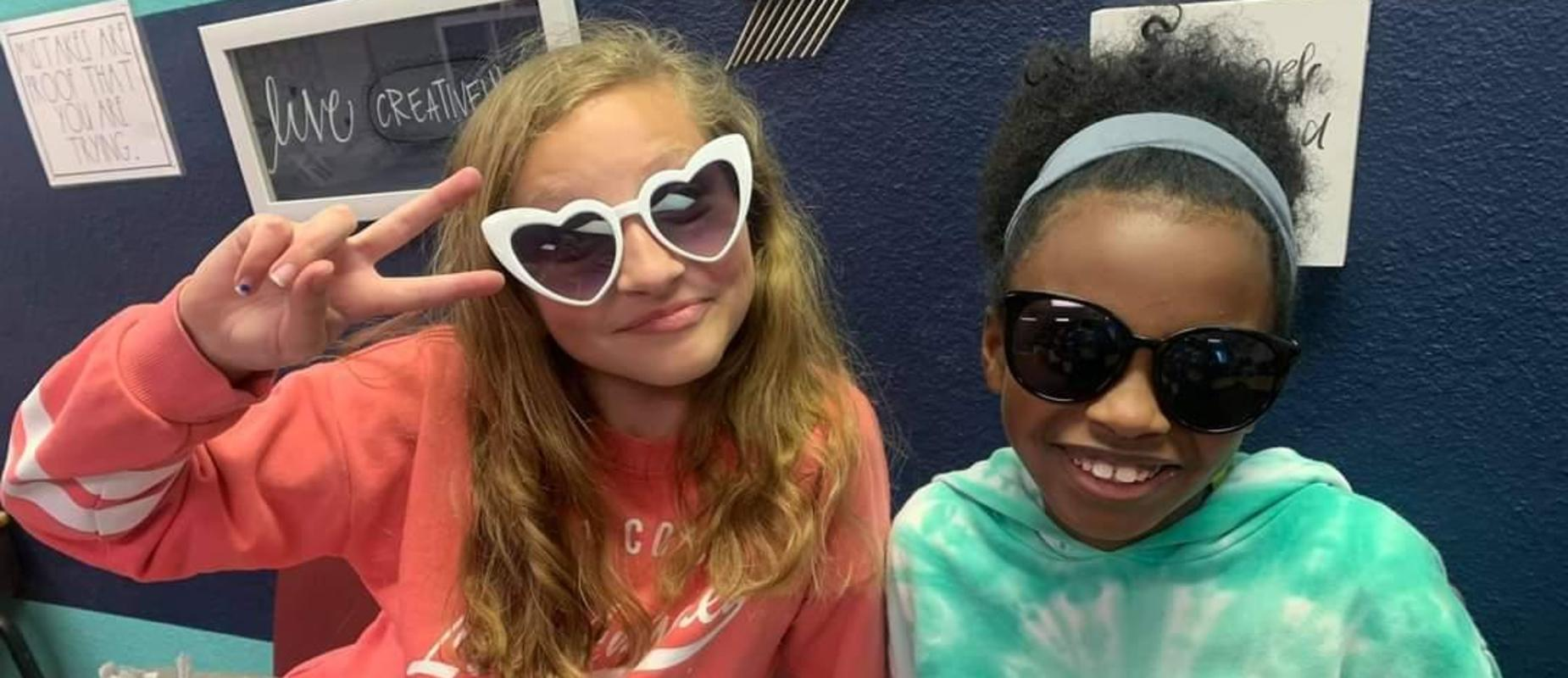 Two students wearing sunglasses