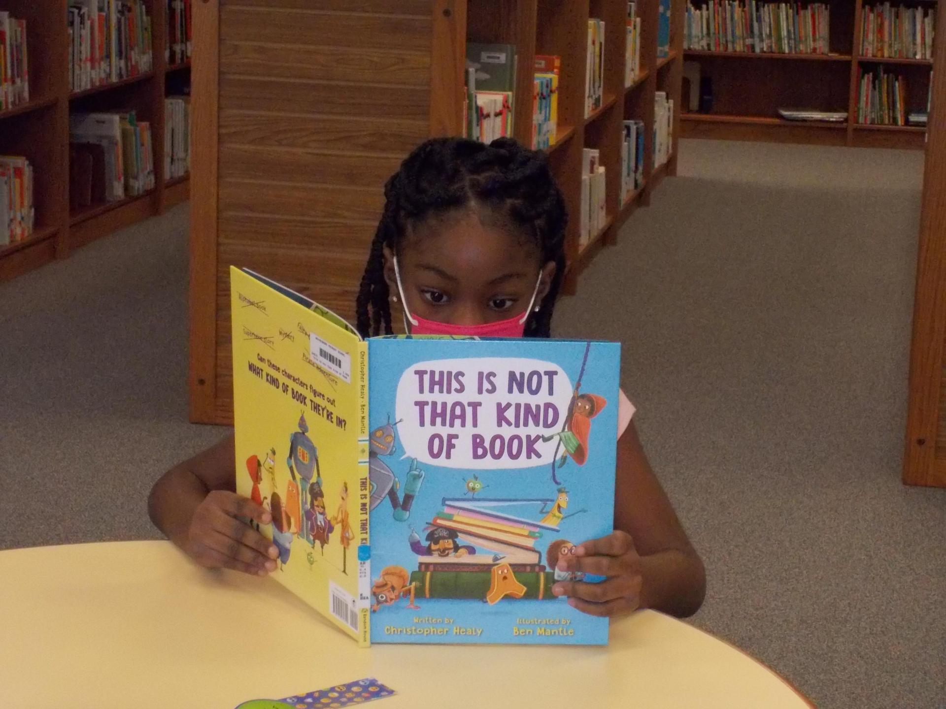 A student enjoys a new book