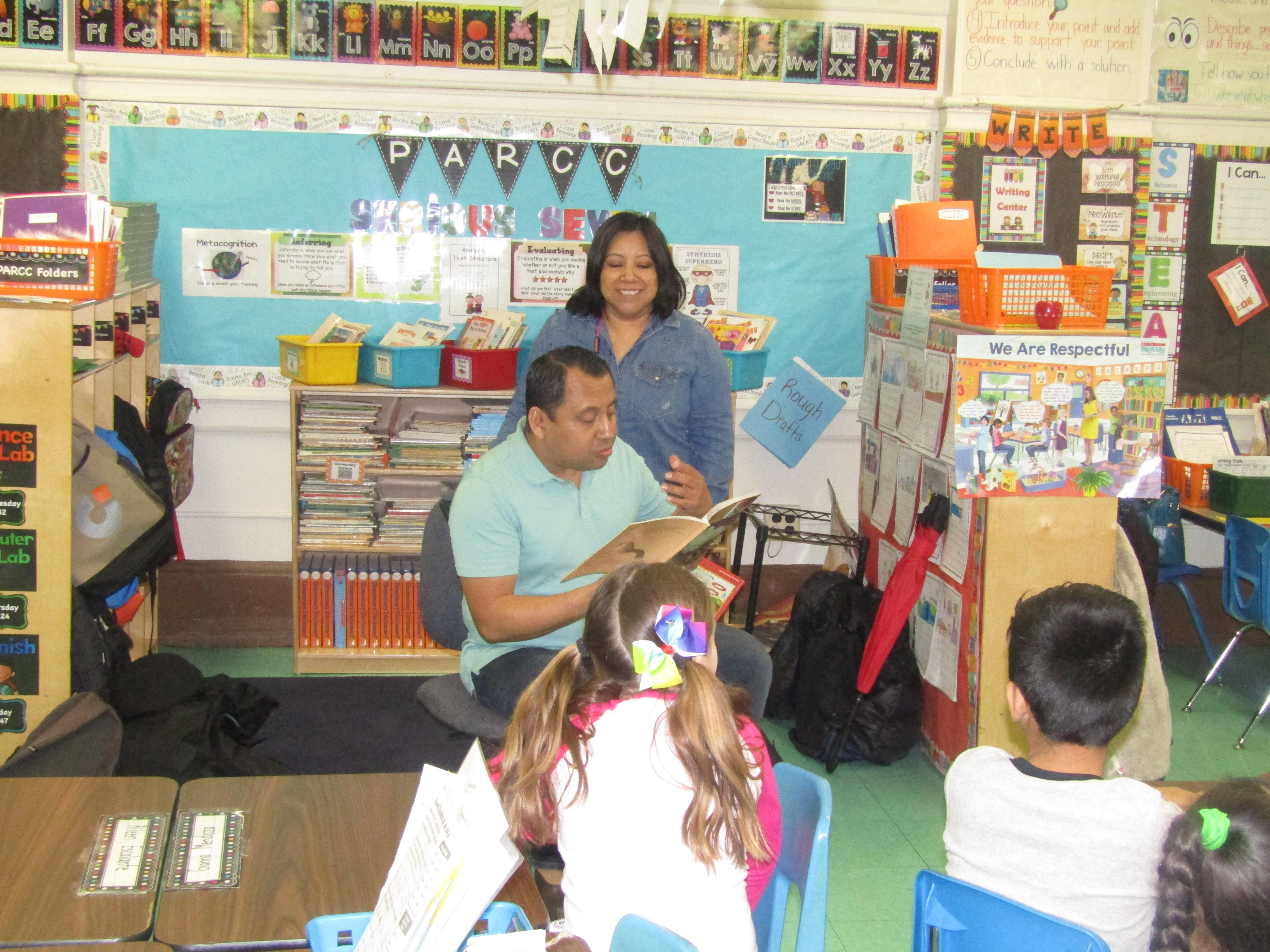 mom & Dad reading to their child's class