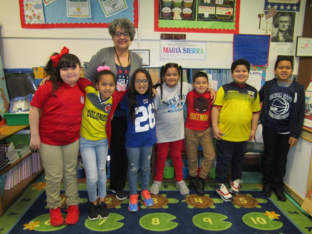 Teacher with her student wearing sports jerseys